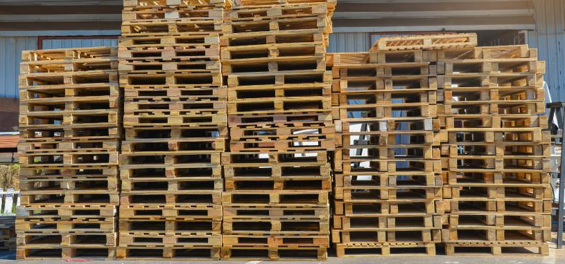 stacked second hand wooden pallets