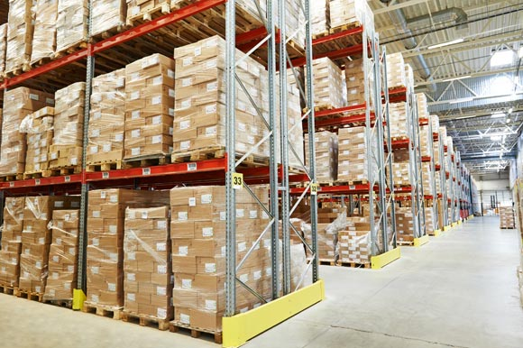 warehouse with stock on transporting pallets